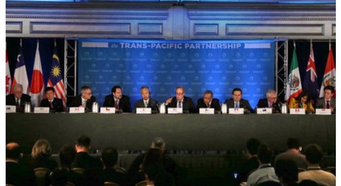 Lãnh ¡o 12 n°Ûc t¡i buoir hÍp báo sau khi k¿t thúc àm phán TPP t¡i thành phÑ Atlanta, Mù. ¢nh: AFP
